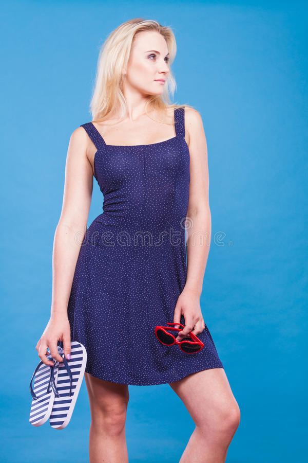 Woman Wearing Short Dress Holding Flip Flops And -2464