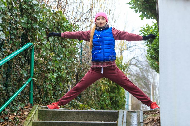 Woman wearing sportswear exercising outside during autumn stock photography