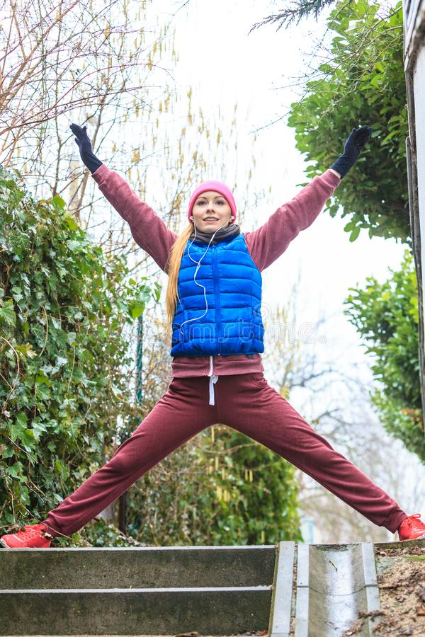 Woman wearing sportswear exercising outside during autumn royalty free stock photos
