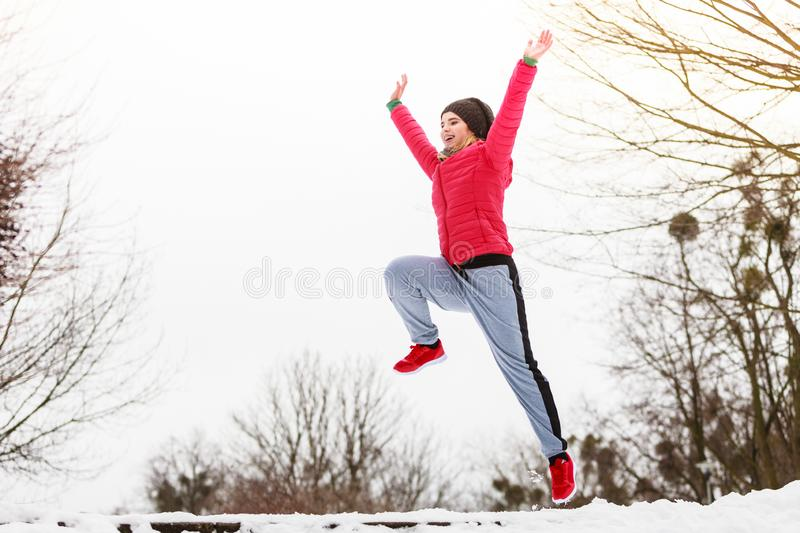 Woman wearing sportswear exercising outside during winter royalty free stock image