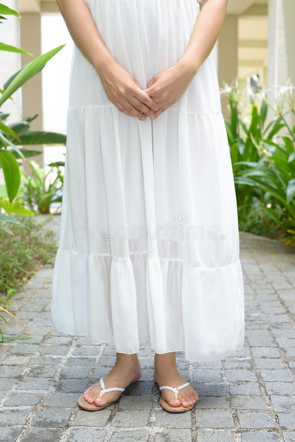 Woman wearing summer dress. Fashionable woman wearing white summer dress stock photography