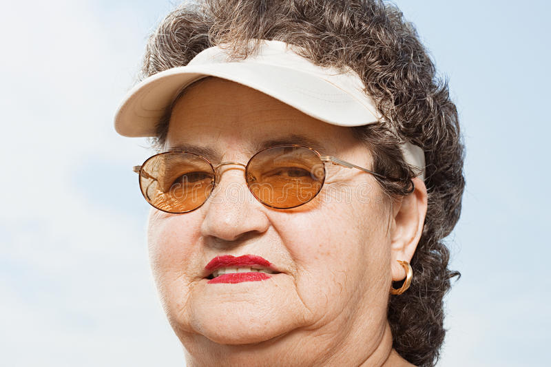 Woman wearing a sun visor royalty free stock image