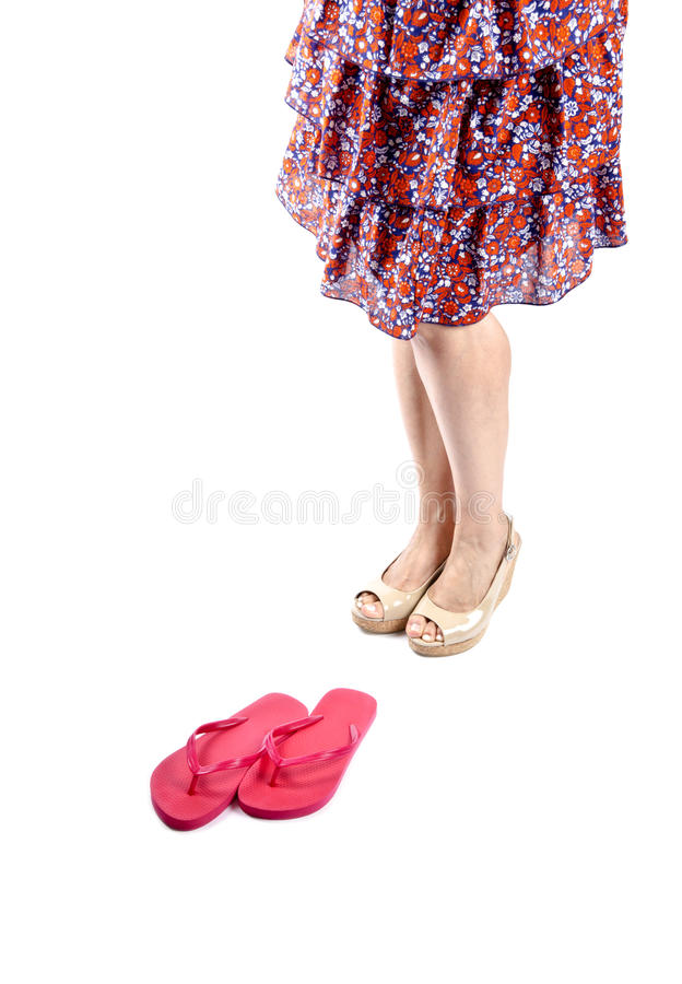 Woman Wearing Sundress and Platform Sandals #3. Woman wearing neutral colored patent platform sandals and floral tiered sundress isolated on white #3 royalty free stock photography