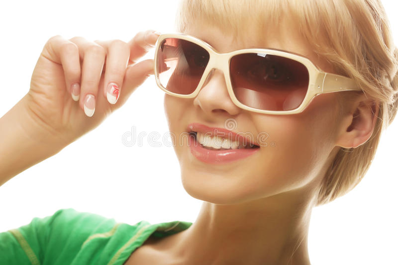 Woman wearing sunglasses over a white background stock photography