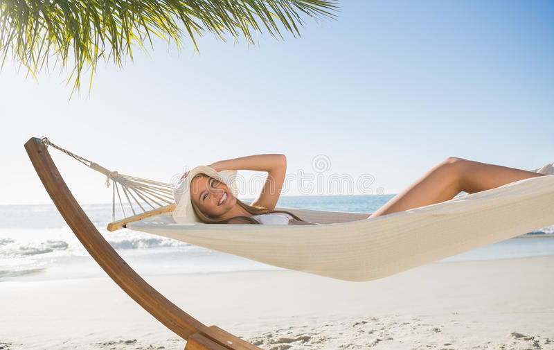 Download Woman Wearing Sunhat And Bikini Relaxing On Hammock Smiling At Camera Stock Image - Image: 33108307