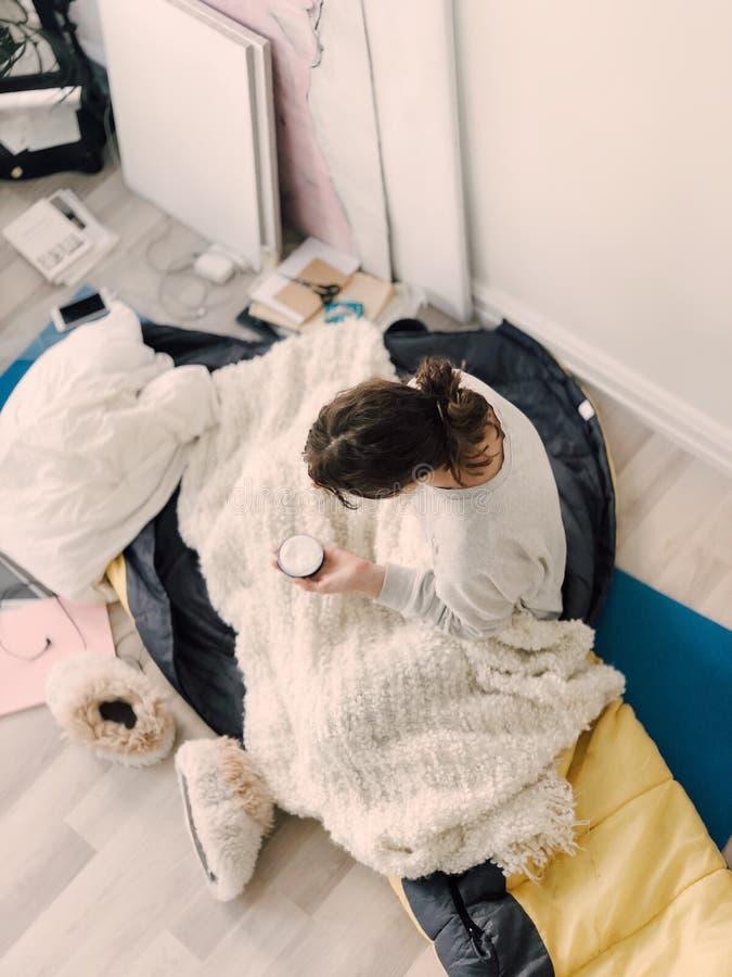 Woman Wearing Sweatshirt Holding Cream Jar royalty free stock image