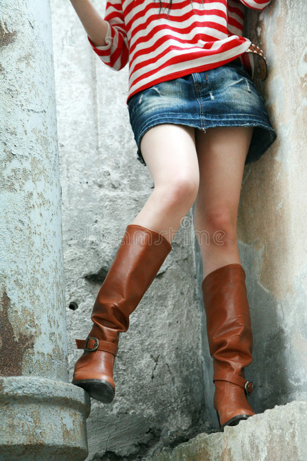 Woman wearing tall boots royalty free stock photo