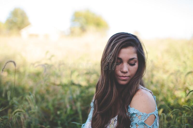 Woman Wearing Teal Off Shoulder While Seating On Grass Photo Free Public Domain Cc0 Image