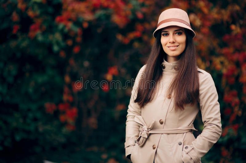 Woman Wearing Trench Coat and a Hat Fashion Portrait stock image