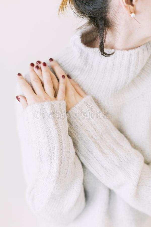 Woman Wearing Turtleneck Sweater in White Surface stock photography