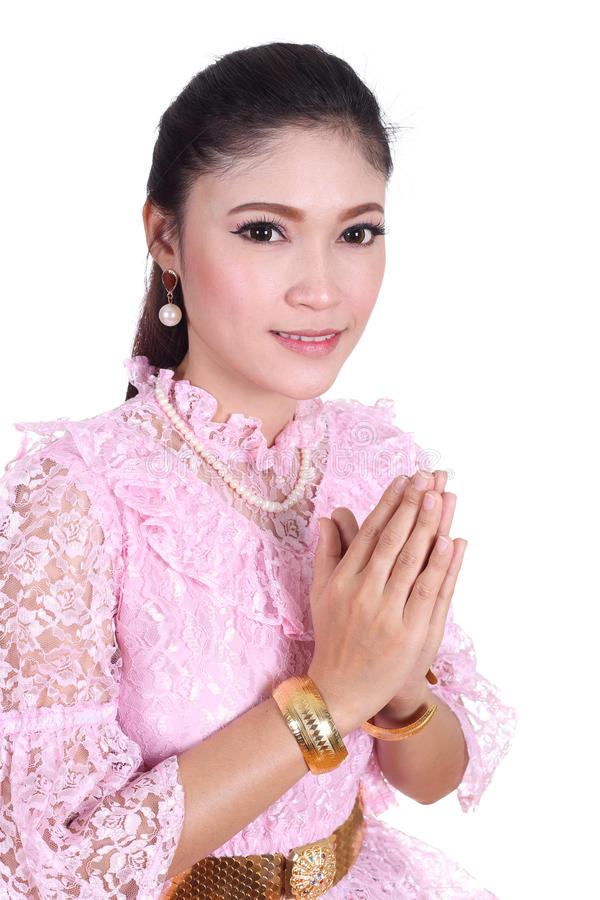 Woman wearing typical thai dress pay respect royalty free stock photos