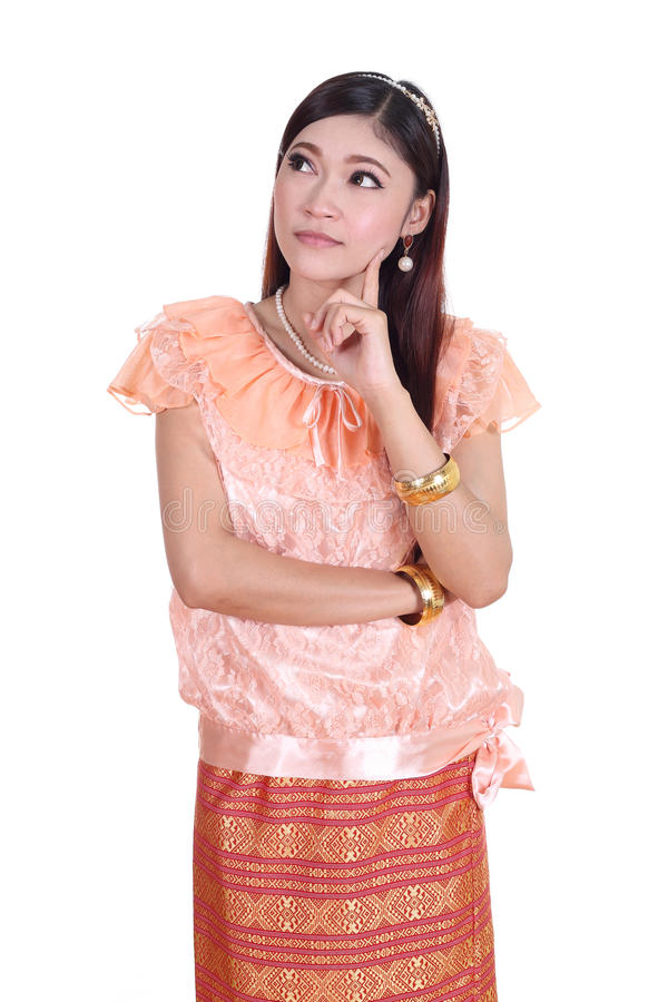 Woman wearing typical thai dress thinking royalty free stock image
