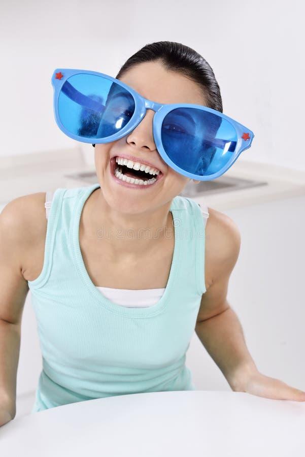 Woman wearing unique glasses stock photos