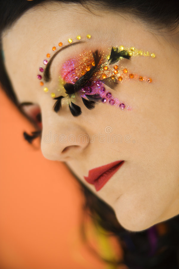 Woman wearing unique makeup. stock photography