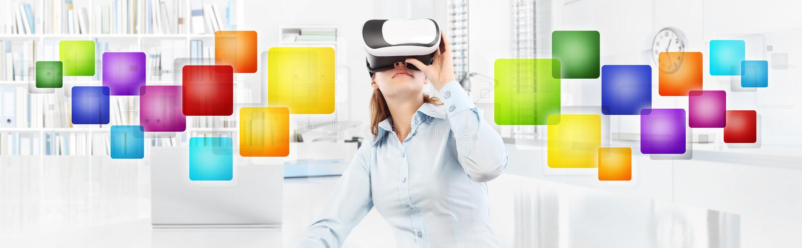 Woman wearing virtual reality glasses in office, with colors empty icons, web banner copy space royalty free stock images