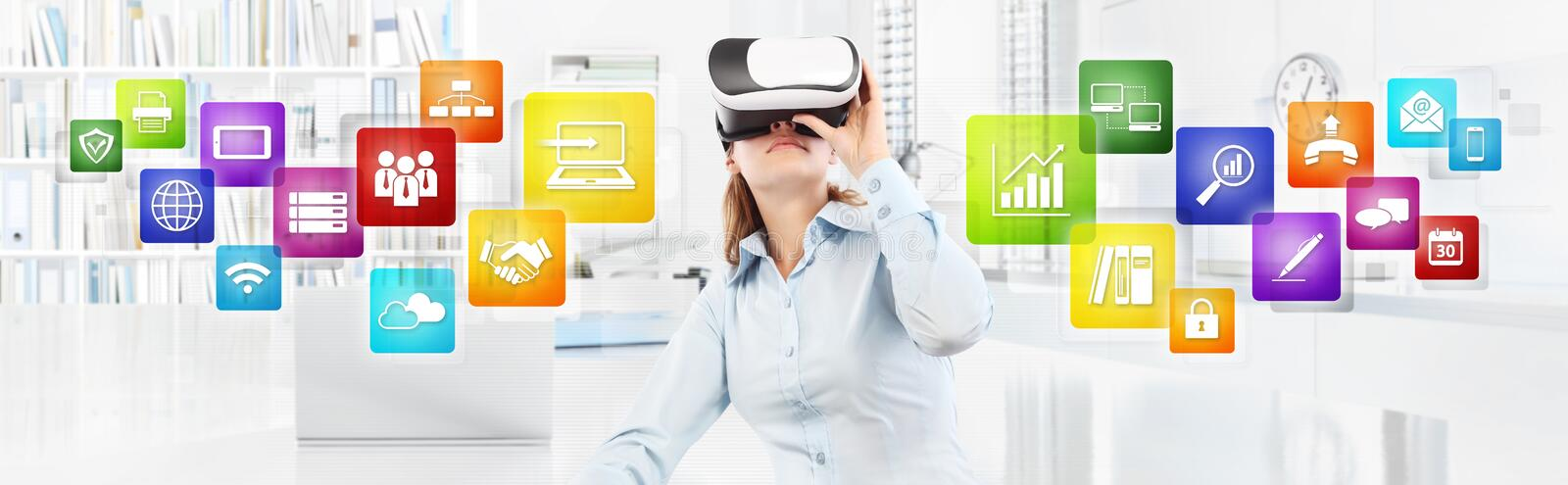 Woman wearing virtual reality glasses in office, with colors icons, web banner copy space stock photo