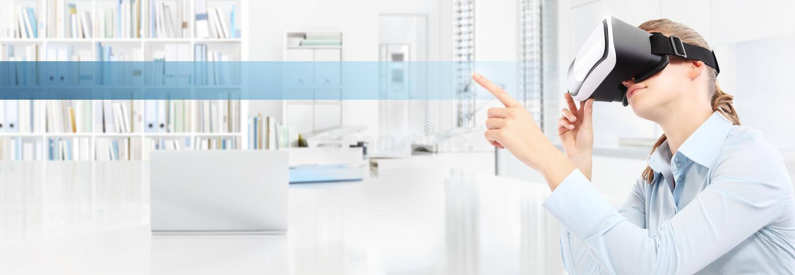 Woman wearing virtual reality glasses in office, hand pointing touch screen with empty icon, web banner copy space stock photo