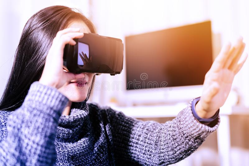 Woman wearing virtual reality glasses. Smartphone using with VR headset stock image