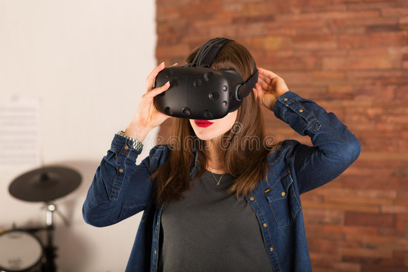 Woman wearing virtual reality glasses. Young woman experiencing virtual reality glasses stock image
