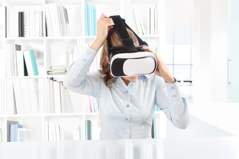 Woman wearing virtual reality goggles headset. VR glasses. 360 royalty free stock photo