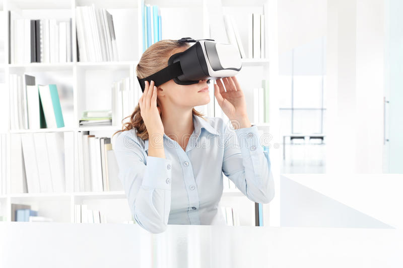 Woman wearing virtual reality goggles headset. VR glasses. 360 stock photo