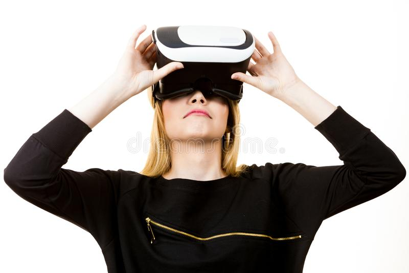 Woman wearing VR goggles. Woman wearing virtual reality goggles headset, vr box. Connection, technology, new generation and progress concept royalty free stock photos