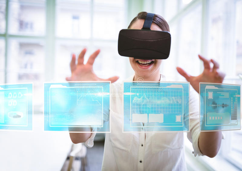 Woman wearing VR Virtual Reality Headset with Interface royalty free stock images