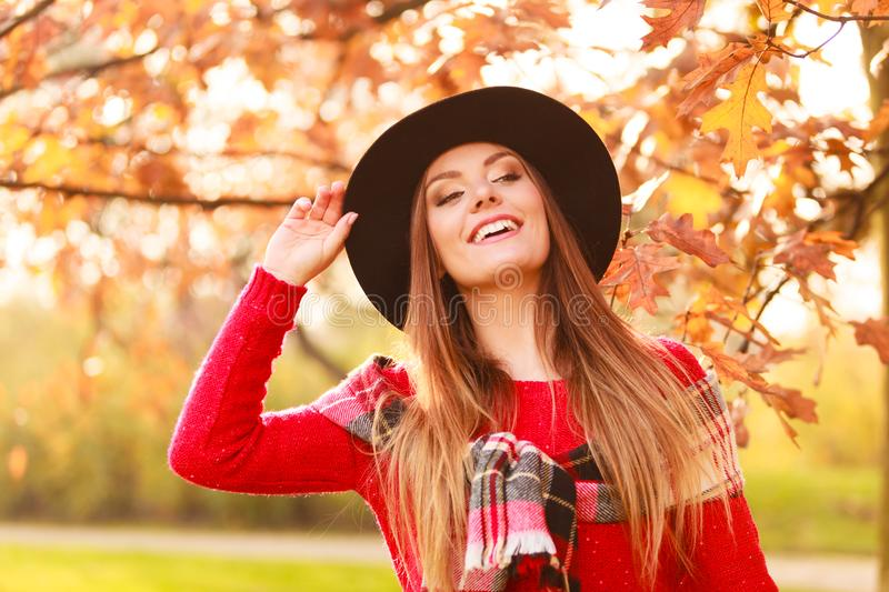 Woman walking in park during autumn stock image