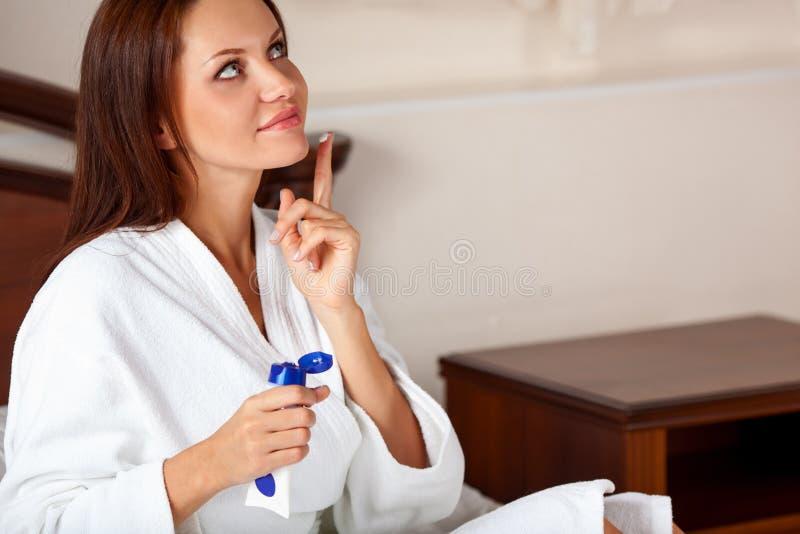 Woman wearing a white bathrobe royalty free stock photos