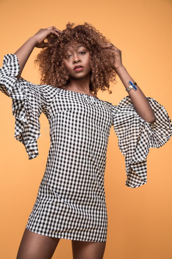Woman Wearing White and Black Checkered 3/4 Sleeved Shirt stock images