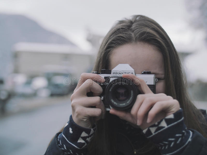 Woman Wearing White and Black Coat Holding Black and Gray Digital Camera royalty free stock photos