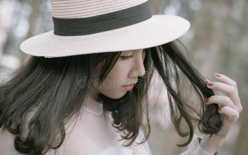 Woman Wearing White and Black Hat royalty free stock image