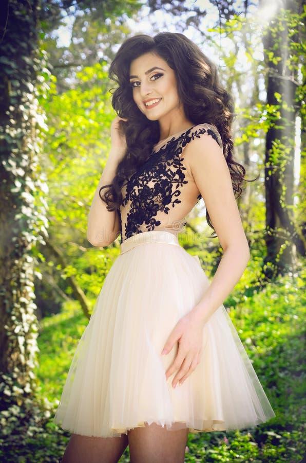 Woman Wearing White and Black Lace Sleeveless Mini Dress royalty free stock photos