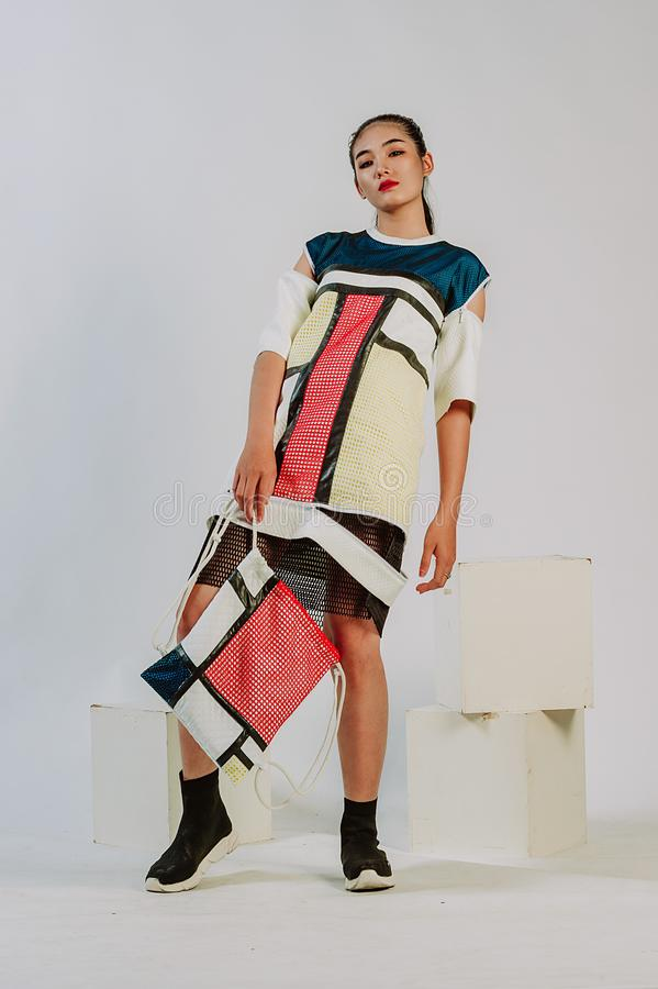 Woman Wearing White-blue-and-red Cold-sleeved Mini Dress and Bag Set royalty free stock images