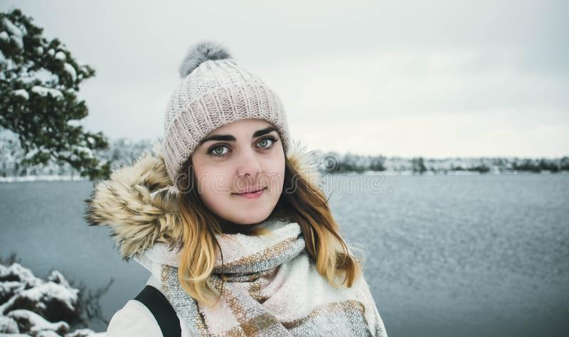 Woman Wearing White Bobble Hat and Jacket royalty free stock photo