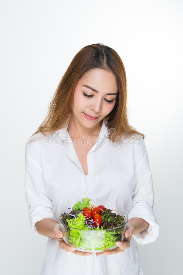 Woman wearing a white bowl holding a salad bowl. royalty free stock photos