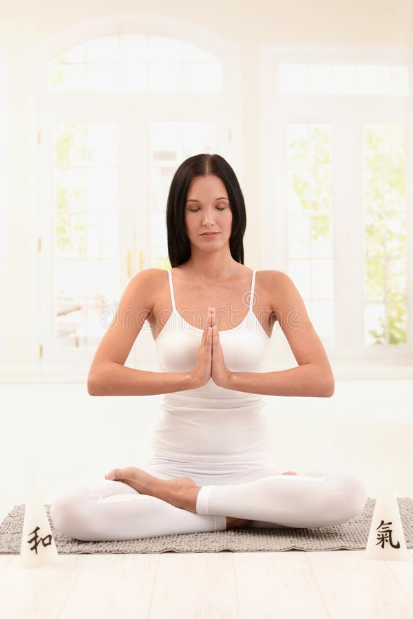 Download Woman Wearing White Doing Yoga Exercise Stock Photo - Image: 24588154