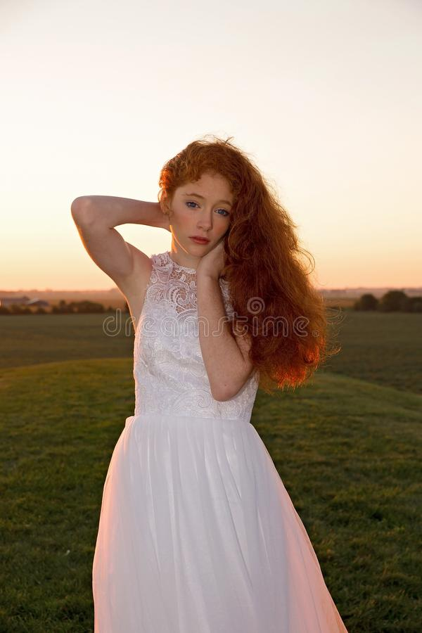 Woman wearing white dress on field royalty free stock photos