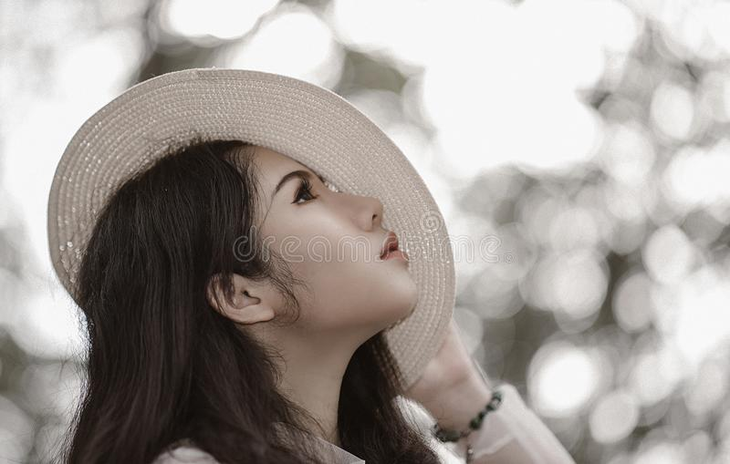 Woman Wearing White Hat See in the Sky royalty free stock photography