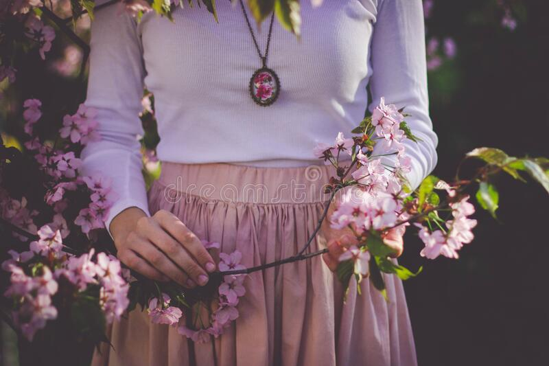 Woman Wearing White Long Sleeve Shirt And Beige Skirt Holding Pink Petaled Flower Free Public Domain Cc0 Image