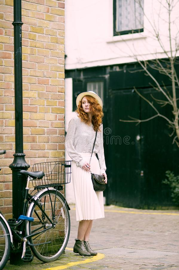 Woman Wearing White Long-sleeved Dress Near Bicycle royalty free stock images