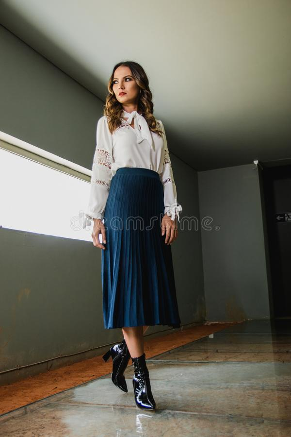Woman Wearing White Long-sleeved Shirt and Blue Skirt stock image
