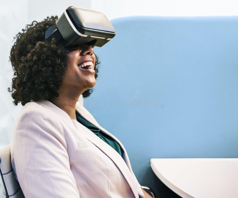 Woman Wearing White Robe and Black Virtual Reality Headset stock photo