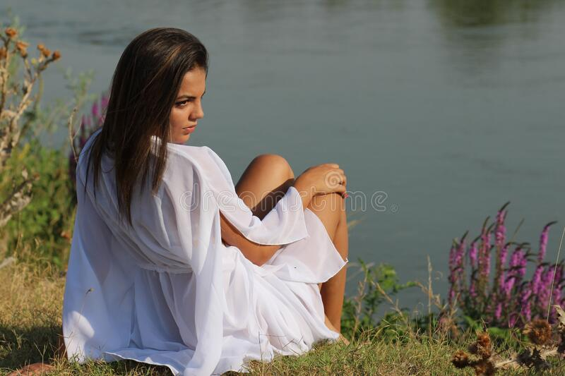 Woman Wearing White Sitting On Green Grass Near Body Of Water Free Public Domain Cc0 Image