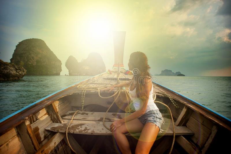 Woman Wearing White Tank Top Seating on Boat royalty free stock photography