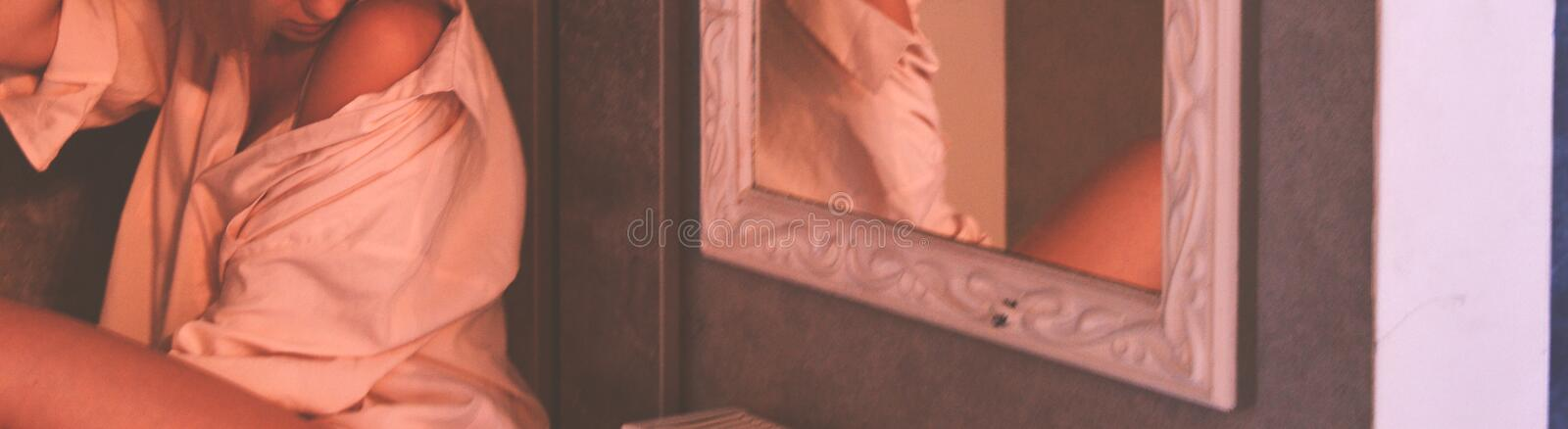 Woman Wearing White Top Near Mirror With White Wooden Frame royalty free stock photography
