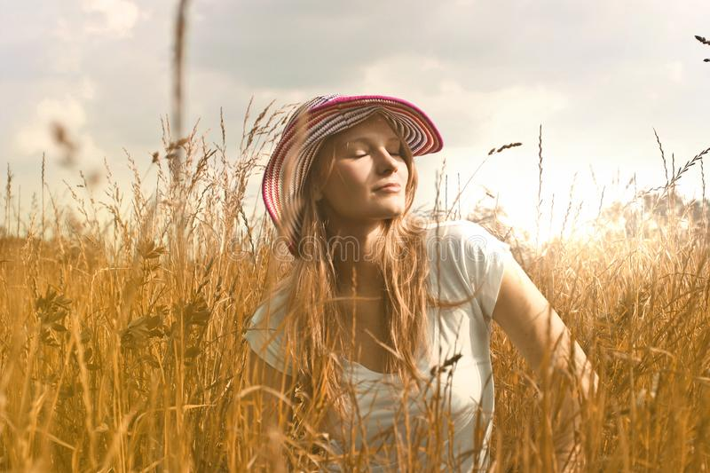 Woman Wearing White Top and Red and White Sunny Hat royalty free stock photos