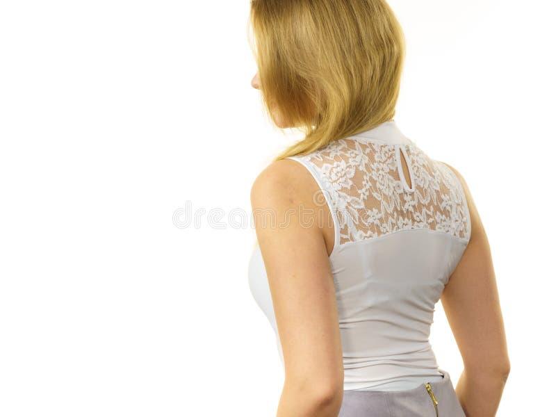 Woman wearing white top stock image