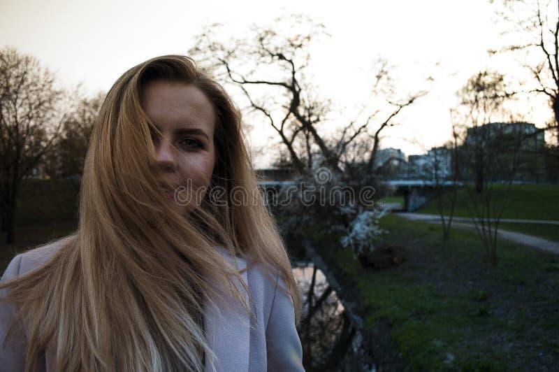 Woman Wearing White Winter Coat While Taking Selfie stock photos