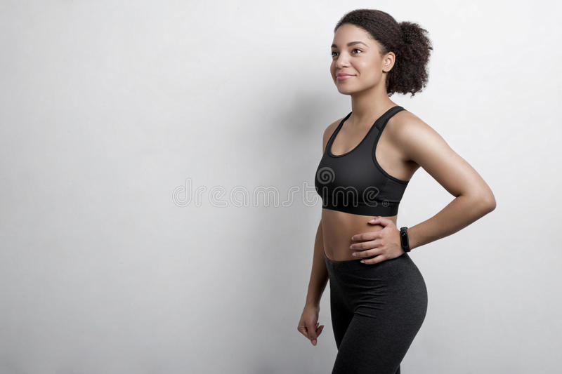 Woman wearing workout clothes with fitness tracker. In studio royalty free stock photography